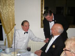 Richard Western & Charklie Headon ( seated) share a joke with John Mutum ( Zone Chairman)